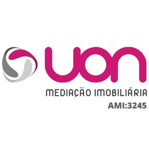 UON Imobiliária logo